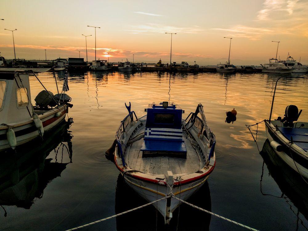 Photo in Landscape #fishing boats #harbor #sunset #sun #colors #orange #red #vasilis photography #greece #killini #port