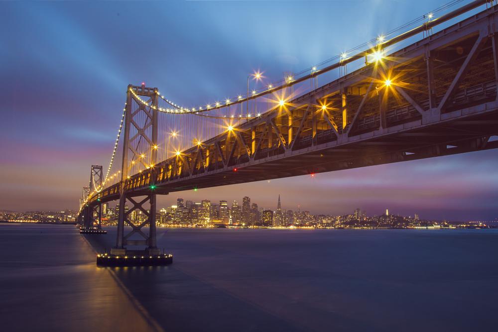 Photo in Cityscape #bay bridge #san francisco #bay area #water #reflection #city #skyline #colours #blue #ocean #long exposure #lights #colors #beautiful