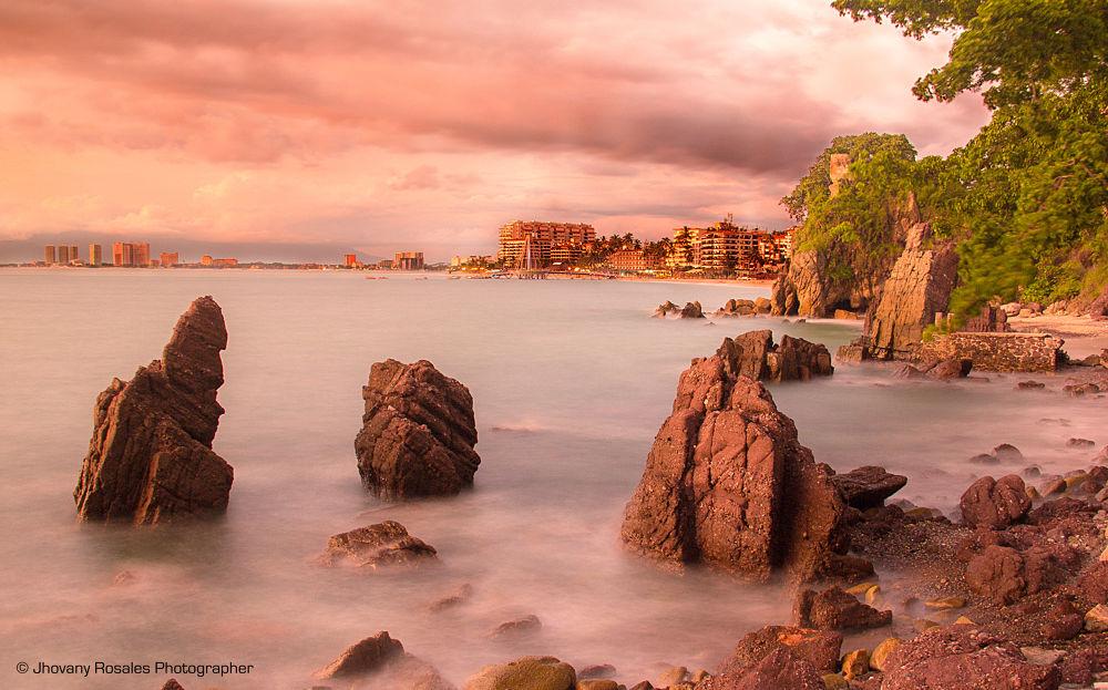 Photo in Landscape #beach #sea #sky #rocks #landscape #city #sunset