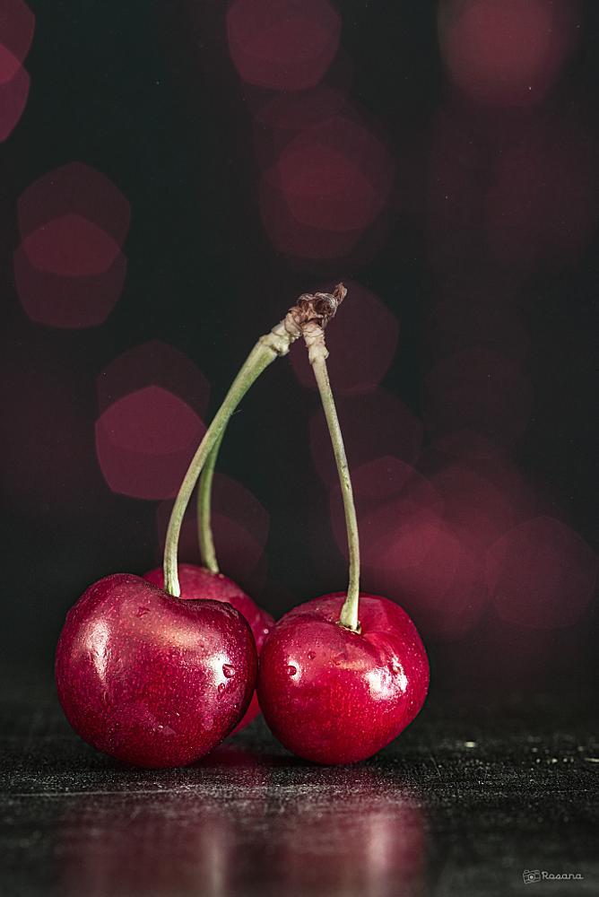 Photo in Still Life #fruits #cherries #red #bokeh #dark #kitchen
