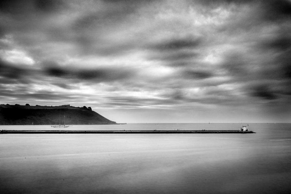 Photo in Landscape #black and white #mood #long exposure #nd #sea #pier #breakwater #sky #clouds