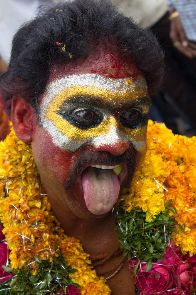 Photo in Portrait #face with makeup #hyderabad bonalu #bonalu #man with color makeup