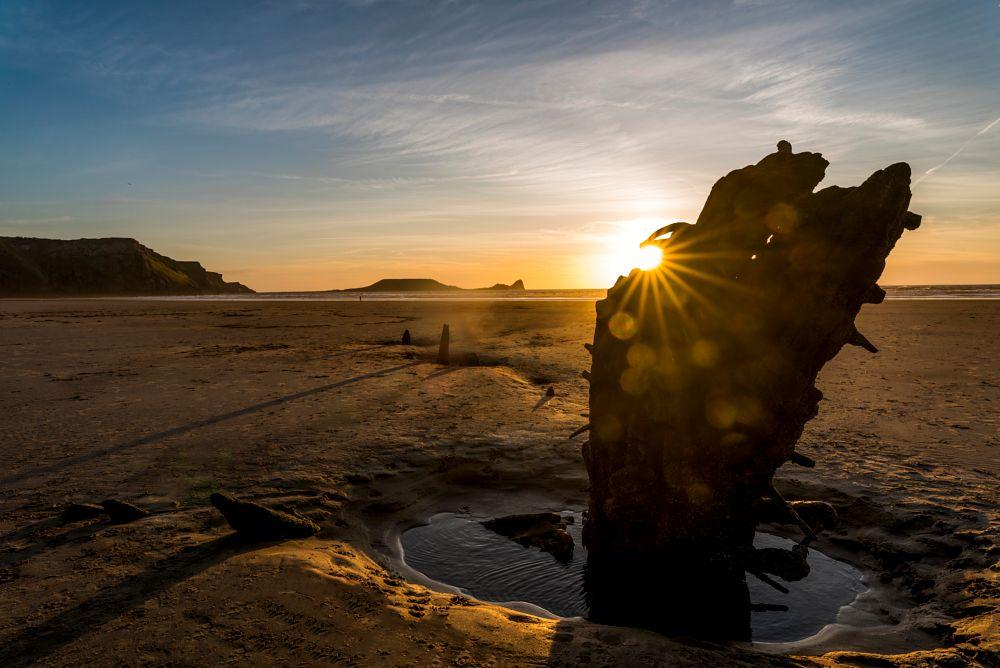 Photo in Landscape #sunset #beach #shipwreck #reflections #bokoh