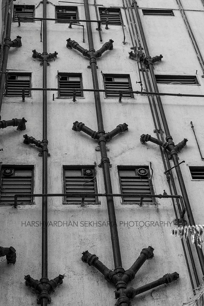 Photo in Architecture #bandra #mumbai #building #architecture #canon #5dmark3 #photography #bombay #india #city #black and white #monochrome #lines #pipes #symmetry #windows