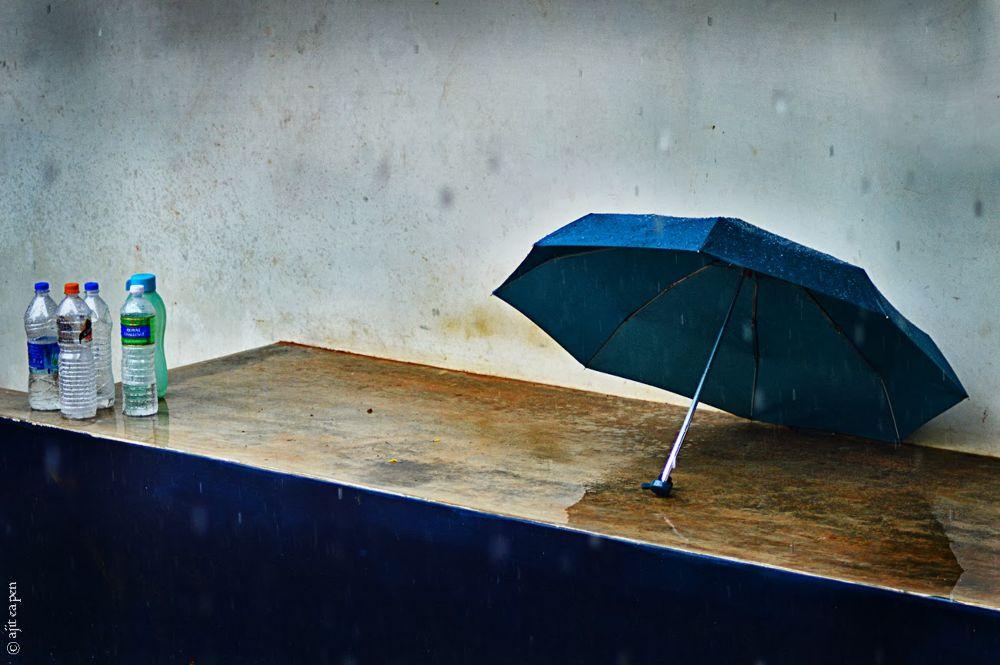 Photo in Abstract #waiting #umbrella #bottles #empty #emptiness #empty bottles #blue #minimal #minimalism #minimalist #fine art #fineart #art #fine #monsoon #rain #drops #wet #damp