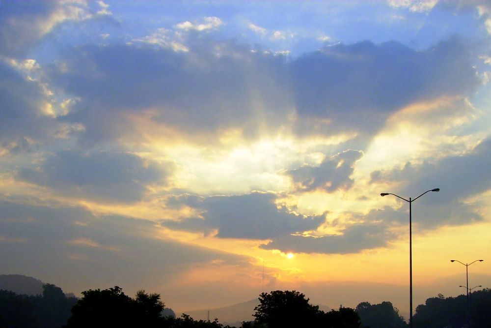 Photo in Nature #sunrise #sun #clouds #city #warm #west virginia