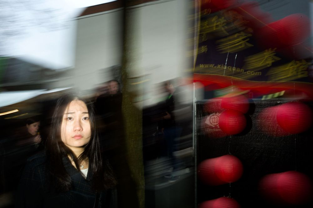 Photo in Street Photography #flash #blur #streetphotography #rotterdam #chinese new year #girl