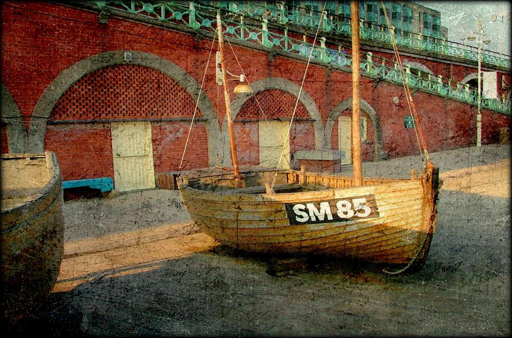 Photo in Cityscape #sailboat #sail #mast #wood #wooden #brighton #beach #england #uk #vintage
