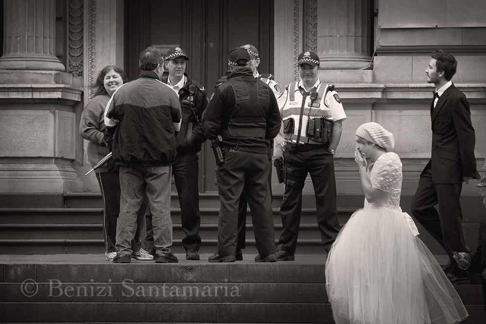 Photo in Street Photography #street #urban #city #parliament #gay #people #man #bride #police #steps #white #white wedding #wedding #marriage #cross dresser