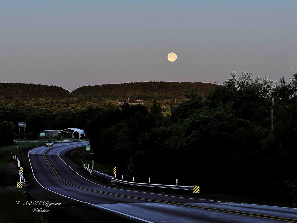 Photo in Landscape #setting moon #moonset as the sun rises #beginning the road trip #our our way early in the morni #setting moon at dawns early li #nature #scenic photos #landscape #scenic texas #nikon photography