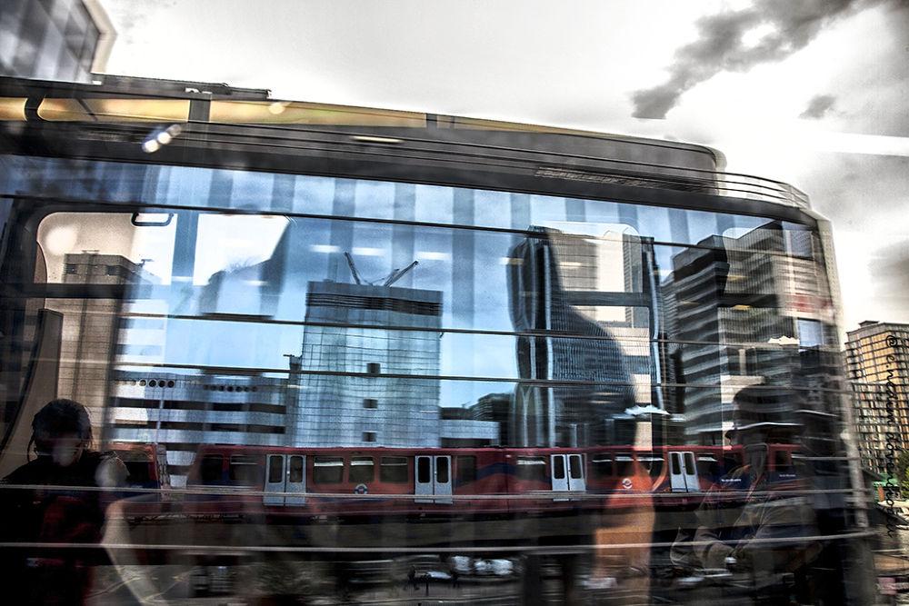 Photo in Random #reflection #train #color #man #architecture #woman #lines