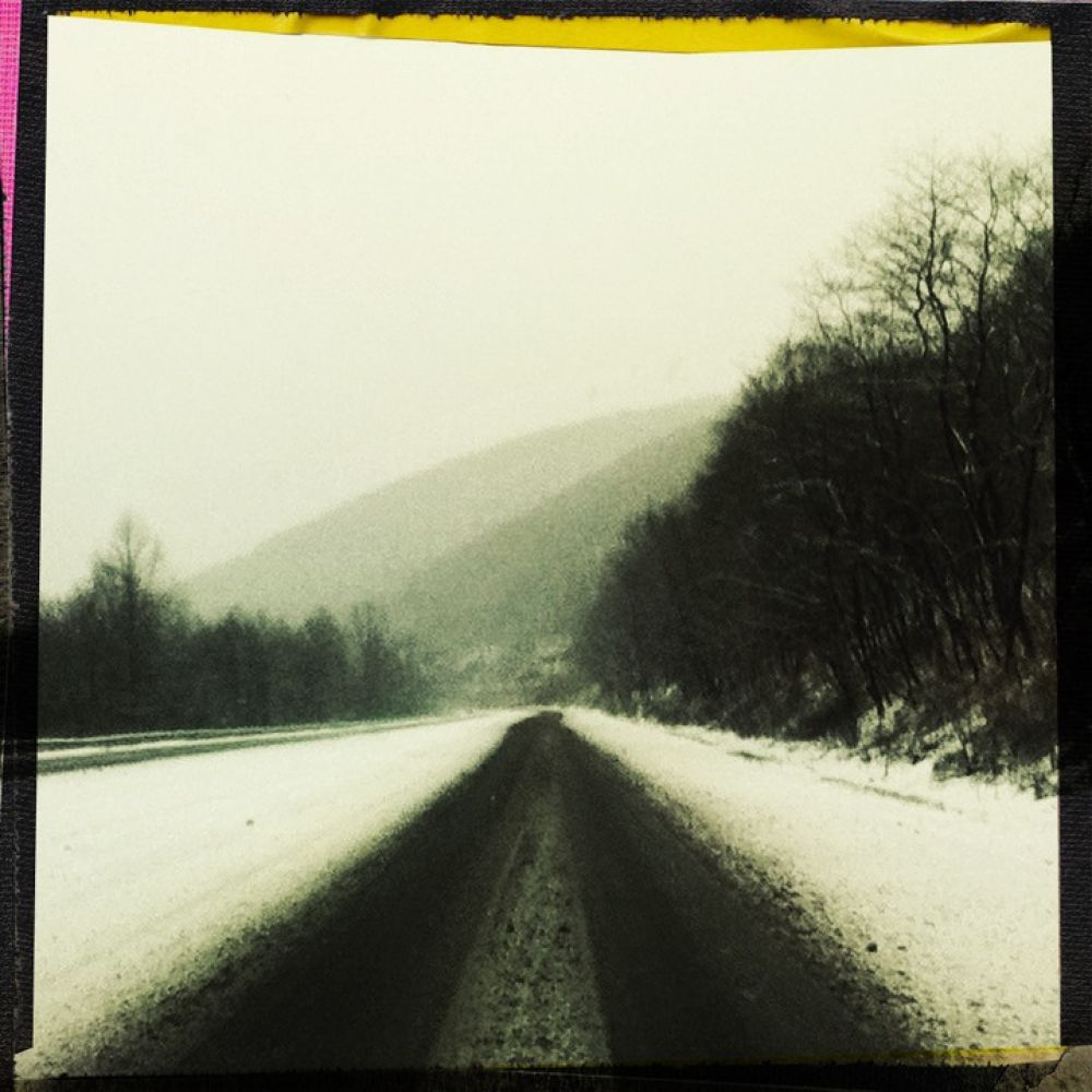 Photo in Landscape #cold #snow #ice #cloudy #gray #white #road #winter #mountains