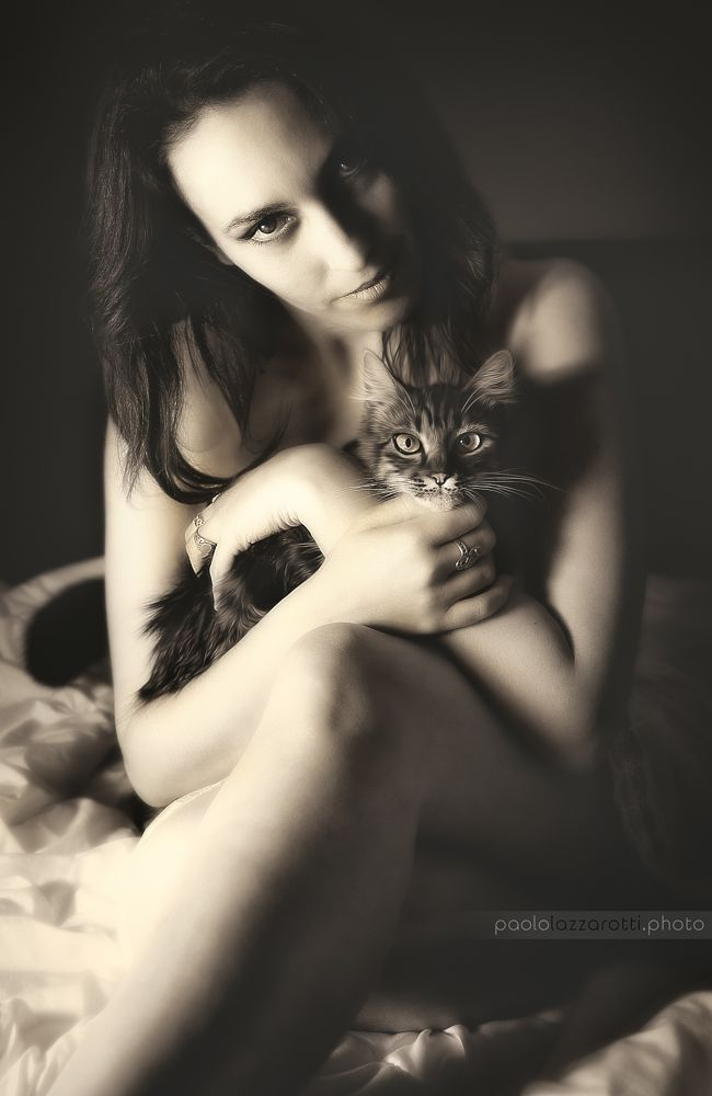 Photo in People #model #cat #sensual #contrast #black and white #bedroom #dark #bright #posing