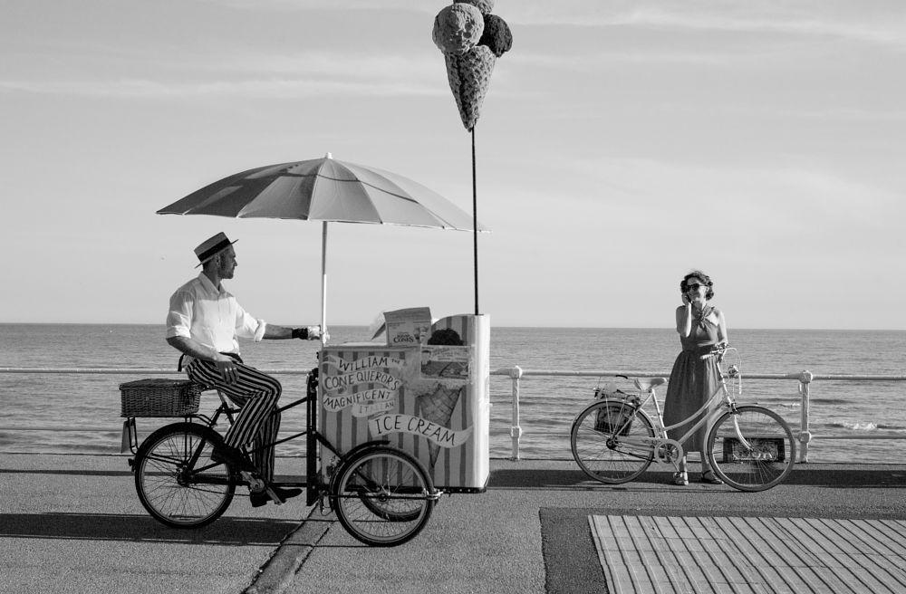 Photo in Street Photography #street photography #ice cream man #st leonards on sea #women #bicycle