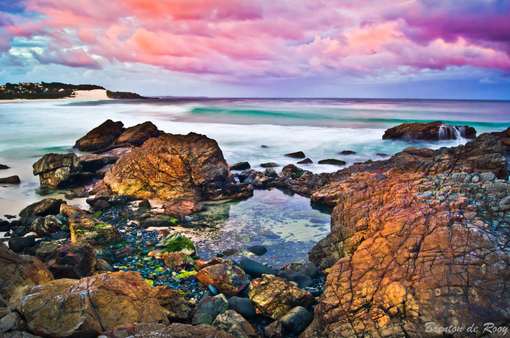 Photo in Landscape #sunset #beach #rocks #sun #sky #clouds #pink #orange #green #yellow #slow shutter #blurred water #long exposure #australia #forster #mid north coast #waves #sea #ocean #spring #rockpool #blue #magic #inspiration #afternoon #sony #life's a beach #sand dune #sand #pebbles
