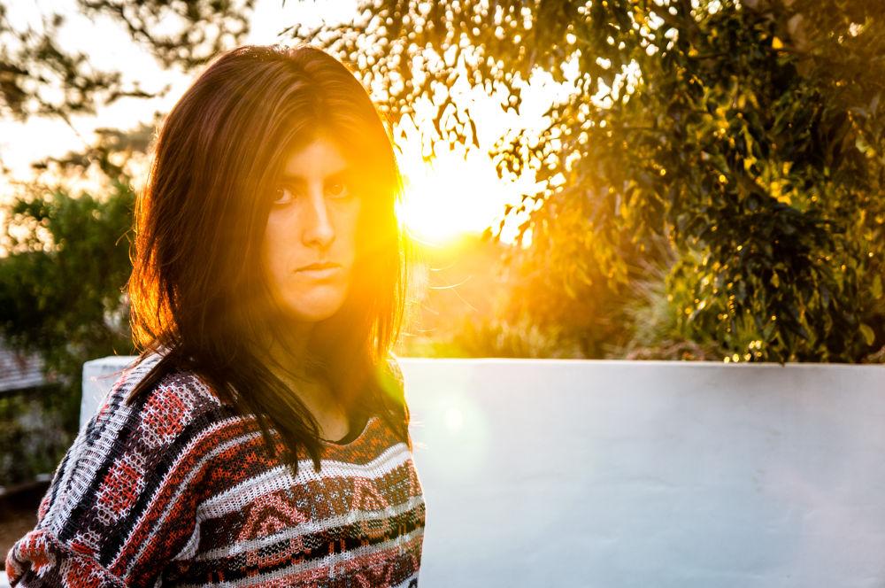 Photo in Random #sunset #portrait #girl #pretty #yellow #golden mean #trees #building #wall #white #green #sony #nex 5n