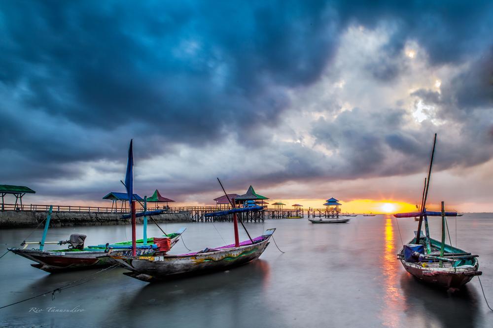 Photo in Landscape #beach #sunrise #boats #clouds #pier