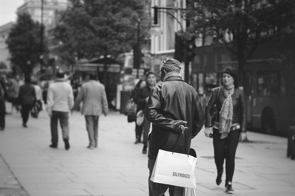 Photo in Street Photography #man #shopping #bags #oxford street #london #street #ypa2013