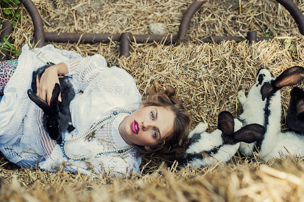 Photo in Portrait #woman #portrait #rabbit #animal #emotion #beauty #folk #poland