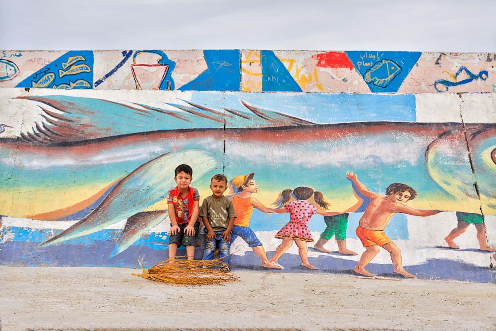 Photo in Street Photography #sea #street #blue #paint #dreams #kids #fishing #boys #brothers #great #amazing #colors