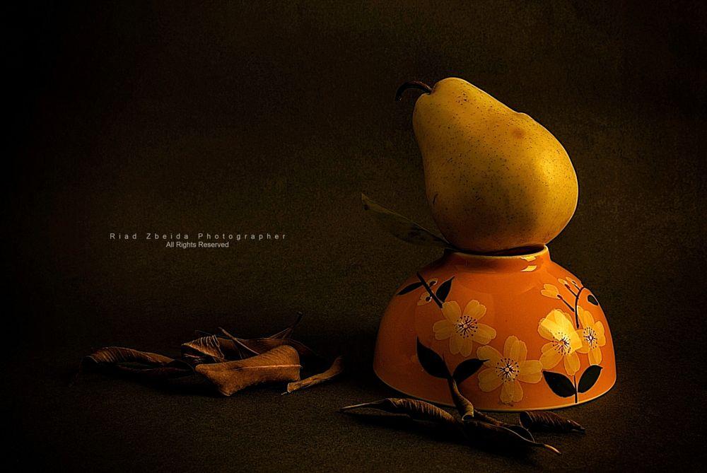 Photo in Still Life #leaves #dark #yellow #fruits #pear #flowers #stilllife