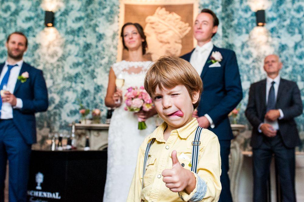 Photo in Wedding #boy #wedding #kid #thumbs up #thumb #silly #funny #bride #groom