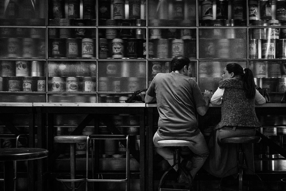 Photo in Street Photography #people #pub #tin cans #bnw #black and white #woman #man #indoors