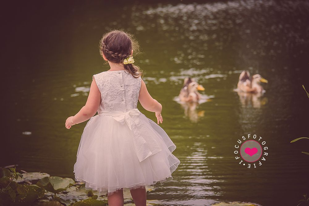 Photo in Family #family #girl #little #princess #bridesmaid #wedding #dress #ducks #pond #looking #outdoors #portrait #cute
