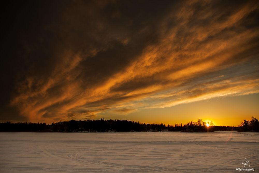 Photo in Landscape #sky #cloud #clouds #sun #sunset #winter #cold #warm #snow #ice #forest #island #sea #landscape #seascape #orange #yellow #finland #canon