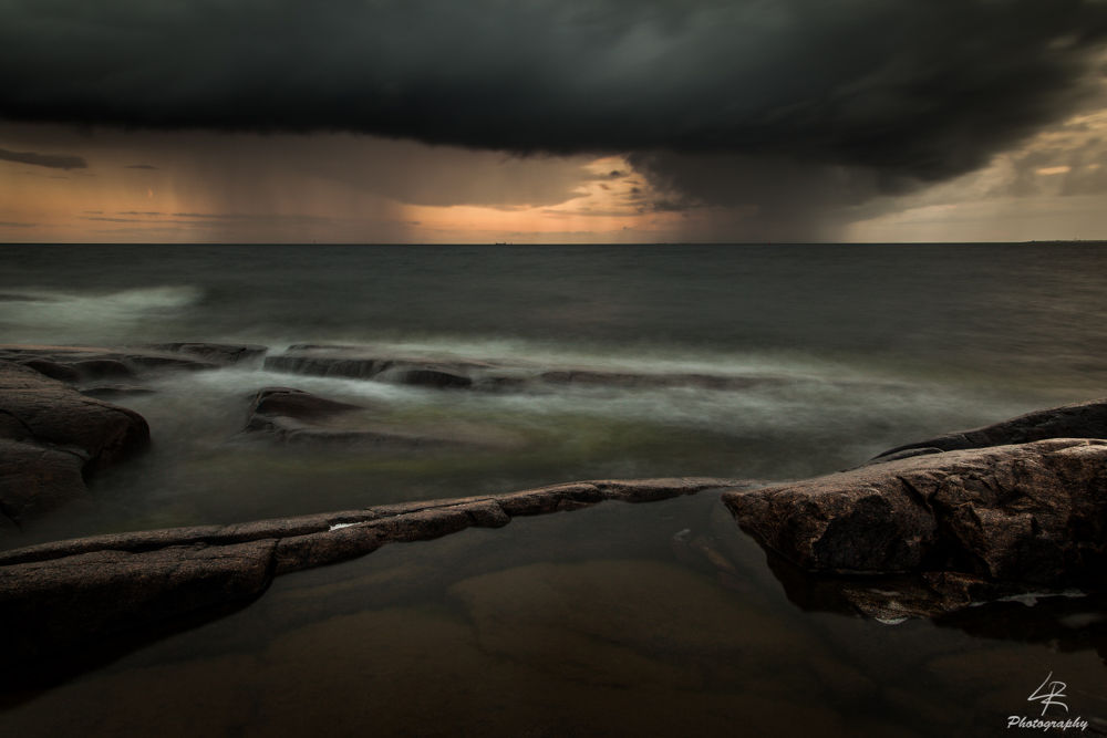 Photo in Landscape #rain #storm #sunset #nature #sea #landscape #seascape #rock #rocks #wave #finland #pori