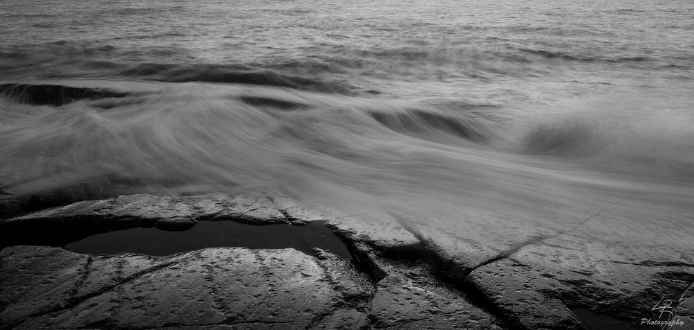 Photo in Landscape #black and white #sea #rock #wave