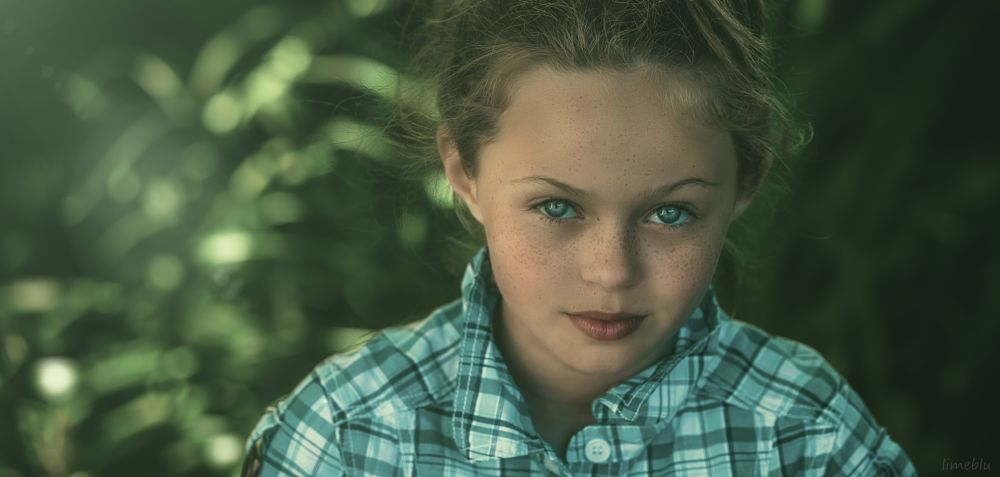 Photo in Portrait #portrait #girl #beauty #freckles #garden #nature #camera #limeblu #color #bokeh #fashion #style #studio #outoftheblu #children #child #magic #travel