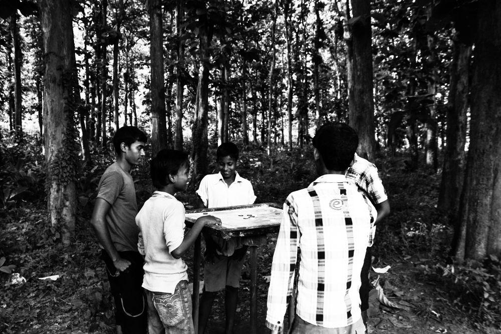 Photo in Street Photography #street #mono #monochrome #b/w #black and white #blackandwhite #feelings #forest #jungle #children #childhood #game #carrom