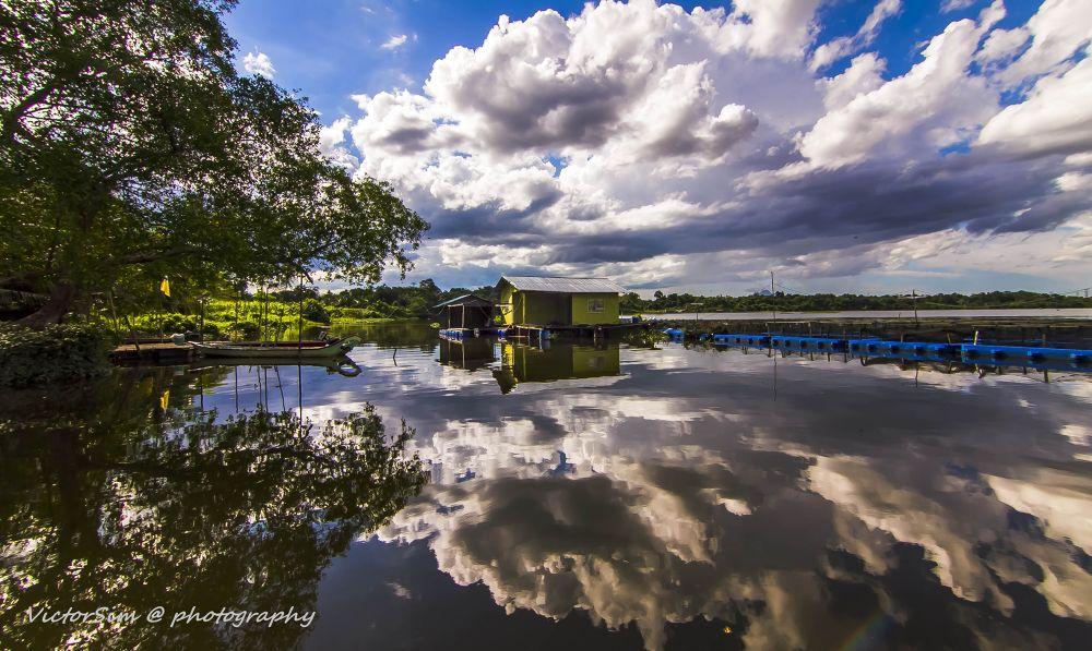Photo in Landscape #clouds #sky #reflections #lake #malaysia #kuching city #sarawak #tropical #boats #trees