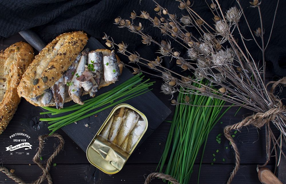 Photo in Food #sardines #bread #black #food #fish #canned #chive #green #wood #light
