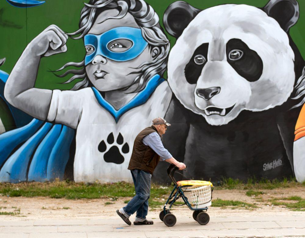 Photo in Street Photography #man #walking #street art #street #street photography #copenhagen