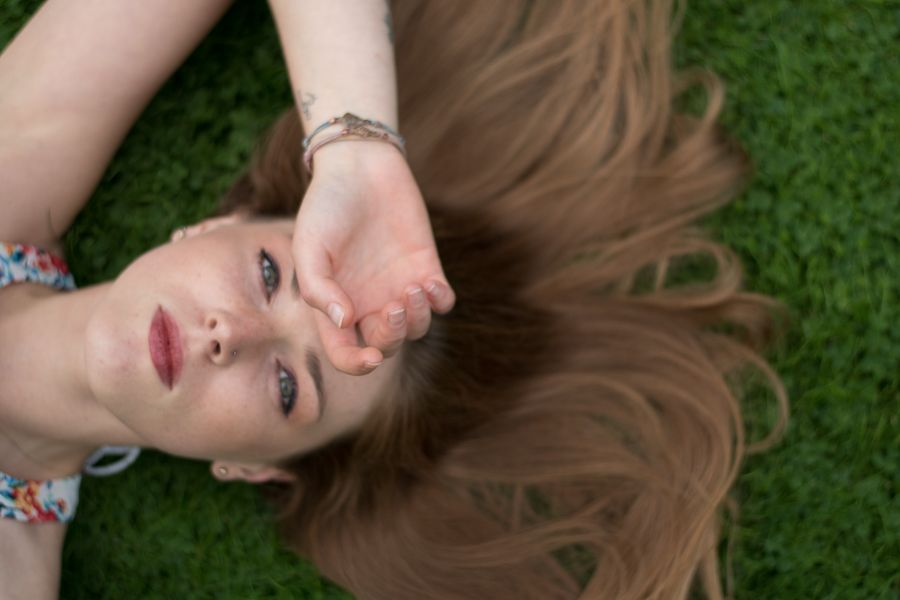 Photo in Fine Art #girl #model #grass #hair #summer #laying