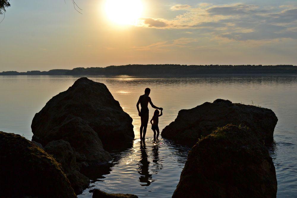 Photo in Random #river #rocks #man #daughter #sunset #danube