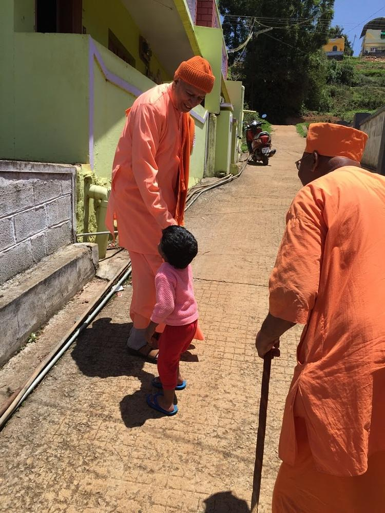 Photo in Street Photography #child #greetings #monks #ooty #streetcontest