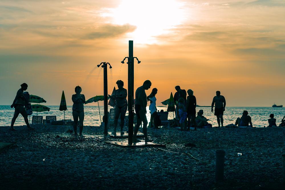 Photo in Street Photography #street #street photo #beach #silhouette #people #sunset #evening #golden hour #bikini #montenegro #bar #travel #sea #seaside #balkan #europe #adriatic #mediterranean #sun #sky #strangers #streetcontest