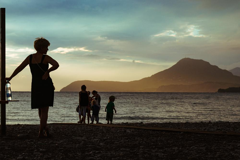 Photo in Street Photography #silhouette #people #street #street photography #sea #seaside #beach #children #evening #sunset #golden hour #scenery #mountains #sky #clouds #woman #summer #travel