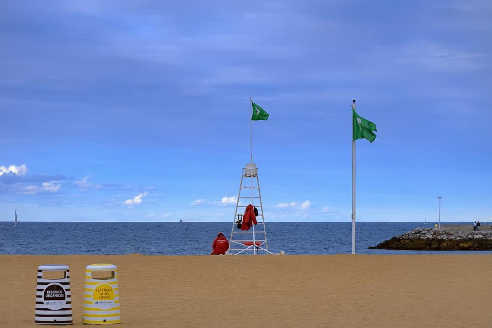 Photo in Street Photography #sea #sand #lifeguard #sky #gijón #asturias #spain #water #arbeyal #beach #sun #summer #flag #green