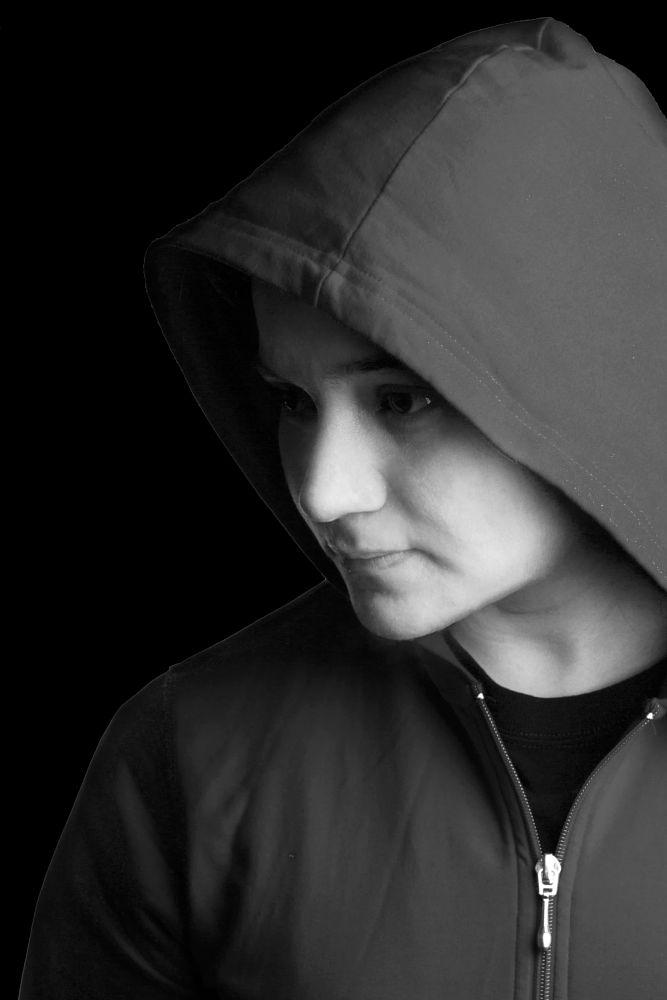 Photo in Portrait #profile #dramatic #lighting #studio #home #hoodie #pose #blackandwhite #portrait