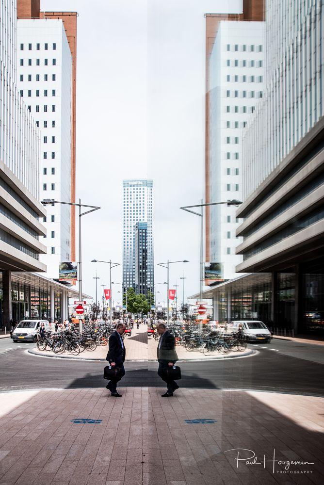 Photo in Cityscape #rotterdam #city #urban #skyscraper #citylife #man #mirror #juxtaposition #streetphotography #candid