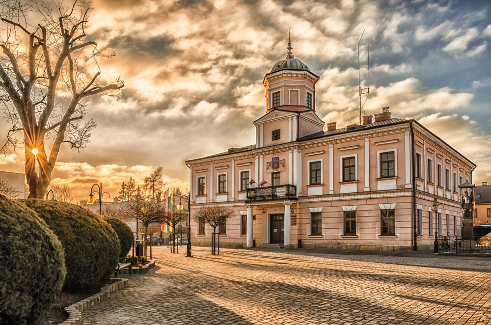 Photo in Architecture #shadows #sunset #sky #city hall #tuchow #poland #architecture