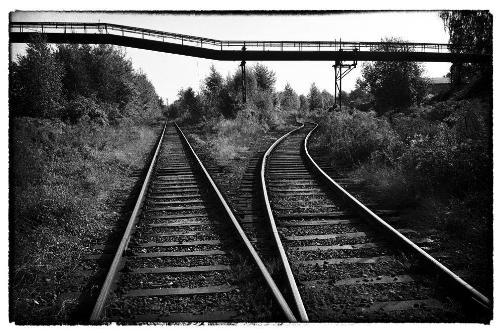 Photo in Industrial #railroad tracks #industrial #black and white #light #black #white #lines #contrast