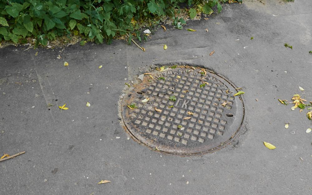 Photo in Cityscape #hatch #metal #city #ground #sewerage