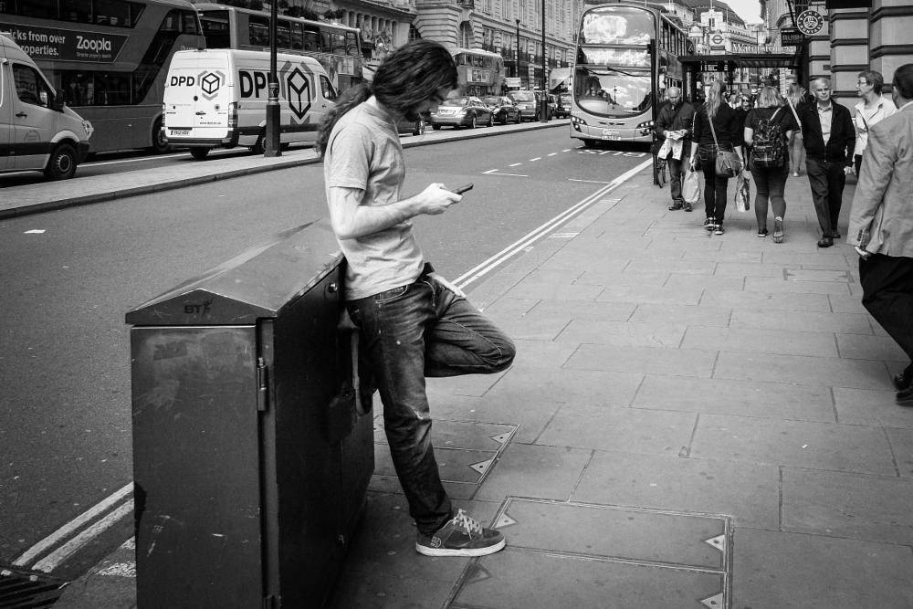 Photo in Street Photography #piccadilly #st. james's #london #uk #adobe lightroom 5.7 #black and white #monochrome #man #mobile #leaning #pavement #street #people
