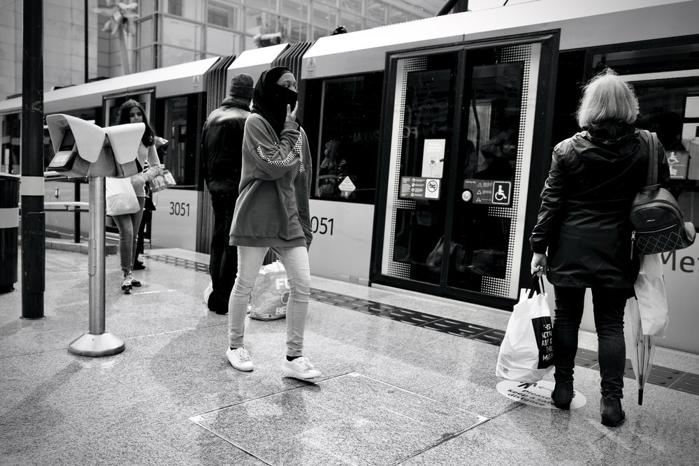 Photo in Street Photography #manchester city centre #exchange square #people #waiting #walking #black & white #metrolink #monochrome #uk #manchester #manchester piccadilly #street #urban #city centre #platform