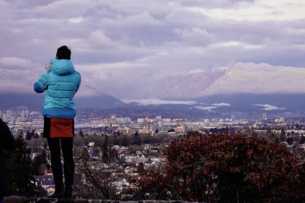 Photo in Urban #snow capped #cityscape #mountains #snow #cold #evening light #urban landscape